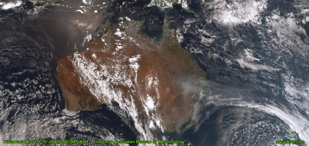 CONTINENT OF FIRE Seen from space, the dark grey plumes of smoke rising from the massive fires in eastern Australia form a grim contrast to the white clouds